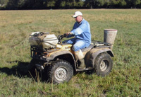 Broadcasting larvicide from the ATV